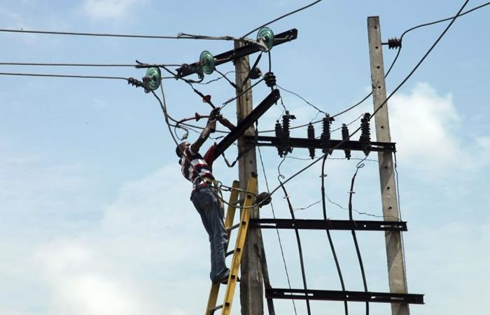 A power line official works