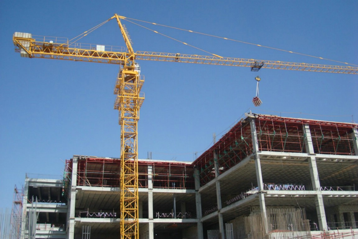 Cranes in construction towering above the rest for Building builder online