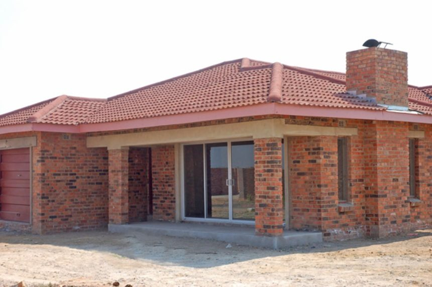 Fbc building society to construct upmarket housing for Cost of building a house in montana