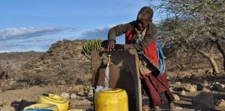 Children collect water in Uwiro Village, Tanzania.